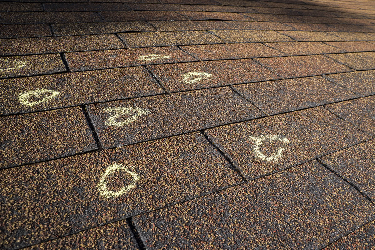 Four Ways Hailstorms Damage Your Roof and Surrounding Property